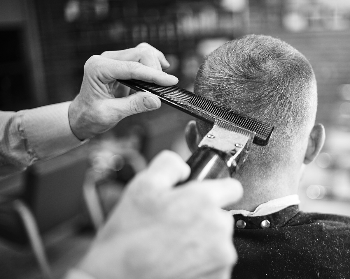 Barber shaving men hair and beard